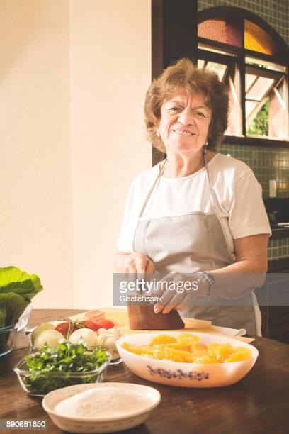 cook in the kitchen preparing feijoada - feijoada imagens e fotografias de stock