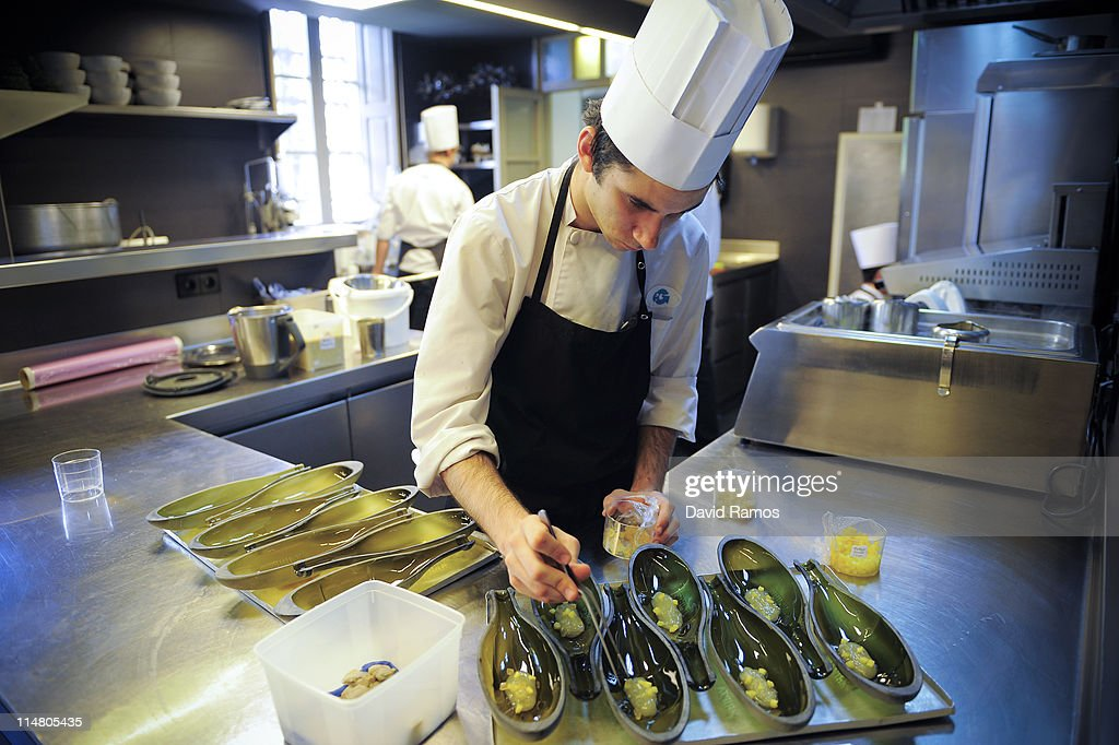 a cook is seen at the spanish restaurant el celler de can roca on