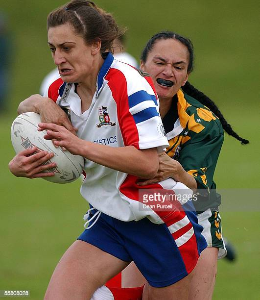 Cook Island player Caroline Marsters tackles Sarah Shillito during the 2002 Womens Rugby League World Cup between Great Britain and Cook Island...