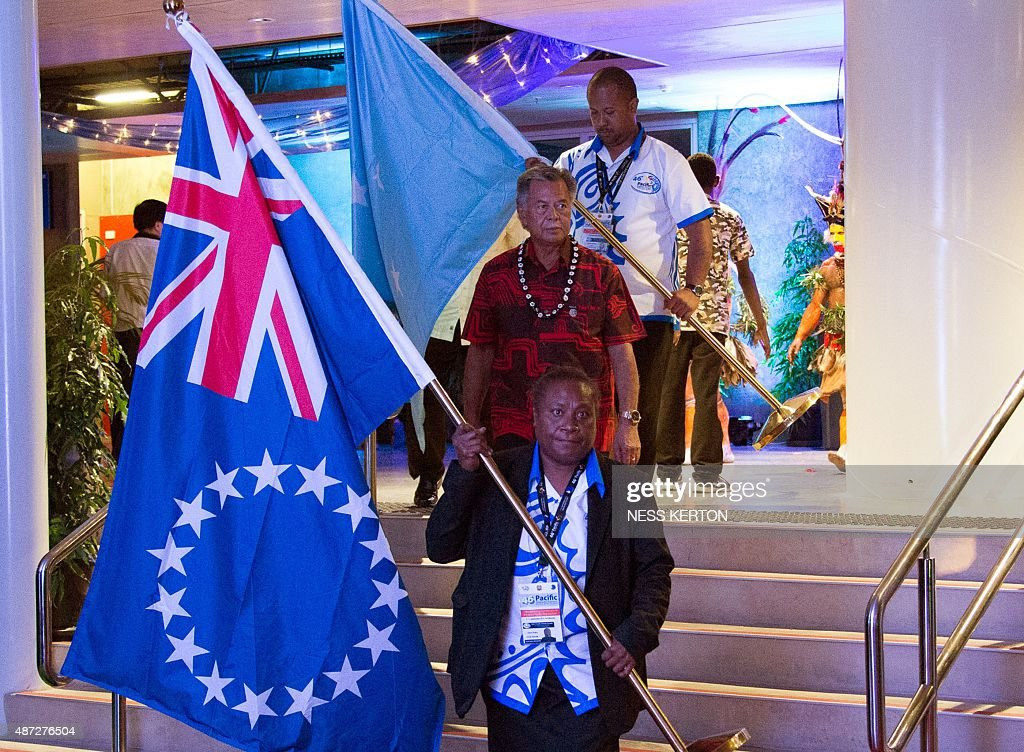Cook Islands Prime Minister Henry Puna (C) arrives for the official opening of the 46th Pacific Islands Forum (PIF) in Port Moresby on September 8, 2015. The 16-nation grouping consists mainly of small island nations, together with Australia and New Zealand, with the two developed nations being accused of dragging their feet on climate change. AFP PHOTO/Ness KERTON