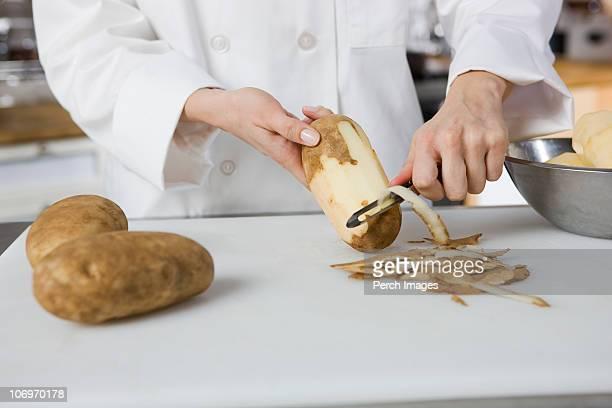 Cook peeling potatoes