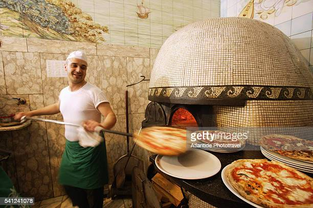 Cook Preparing Pizza at Trianon Pizzeria