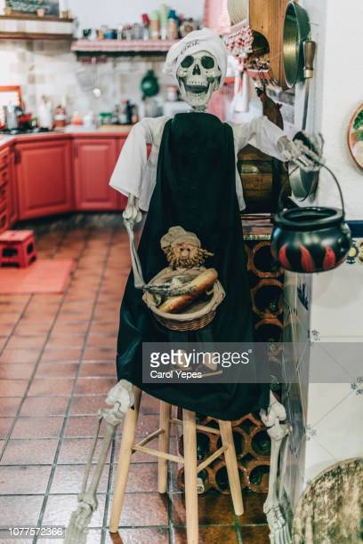 cook  skeleton dressed up like a chef in domestic kitchen - carol cook stock pictures, royalty-free photos & images