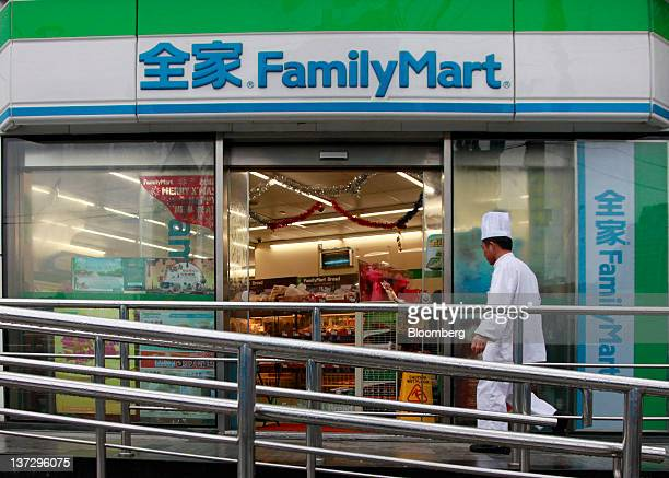 A cook walks into a FamilyMart Co convenience store in Shanghai China on Sunday Jan 15 2012 FamilyMart Co Japan's largest convenience store operator...
