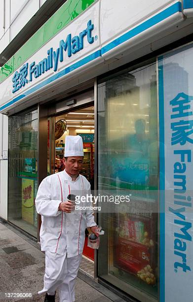 A cook walks out of a FamilyMart Co convenience store in Shanghai China on Sunday Jan 15 2012 FamilyMart Co Japan's largest convenience store...