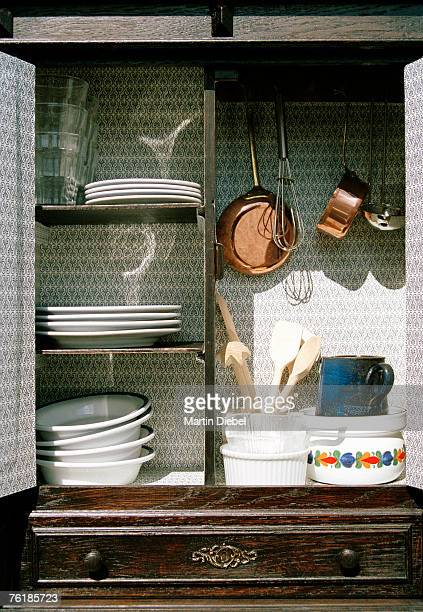 Cook wear and crockery in a cabinet