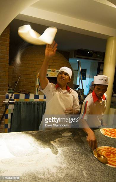 CONTENT] cook with pizza dough in motion in an Italian restaurant in Bangkok Thailand