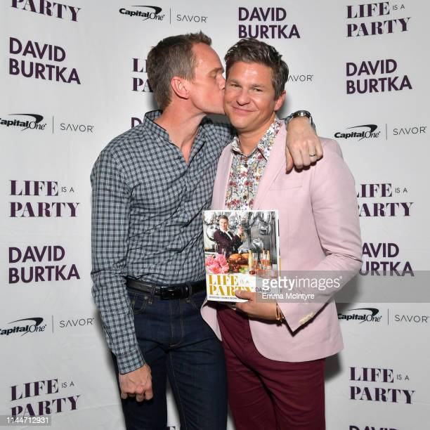 Cookbook author David Burtka and husband Neil Patrick Harris celebrate the launch of Life Is a Party with the Capital One Savor® credit card on April...