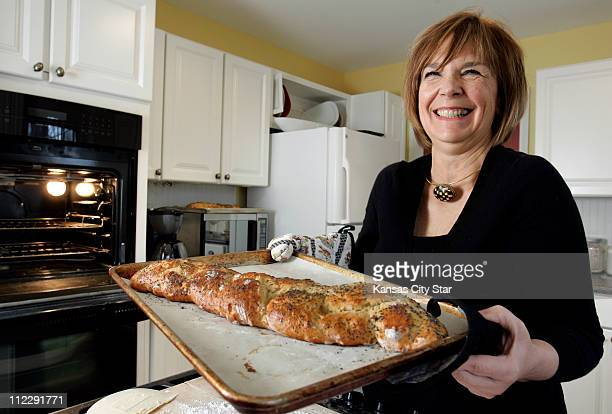 Cookbook author Judith Fertig pulls a loaf of clover honey challah from the oven at her home in Overland Park Kansas The noknead recipe is in new...