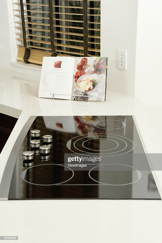 Cookbook on a kitchen counter : Foto de stock