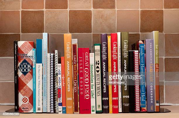 Cookbooks on kitchen shelf