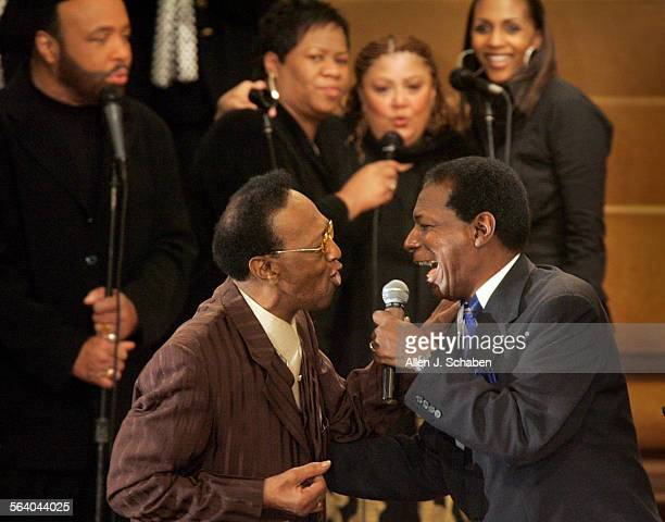 LC Cooke left brother of soul legend Sam Cooke and singer Willie Rogers sing together during funeral services for singer Lou Rawls at the West...