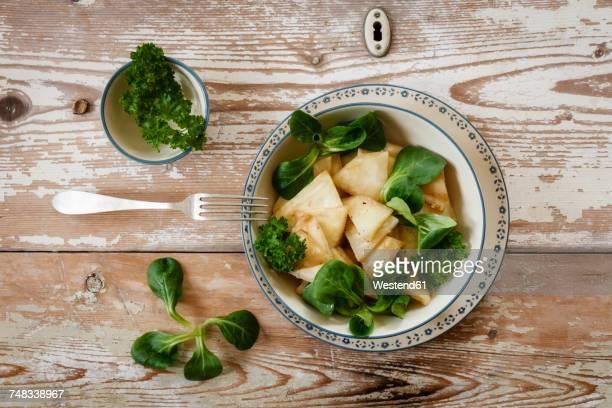cooked celery salad with parsley - celeriac - fotografias e filmes do acervo