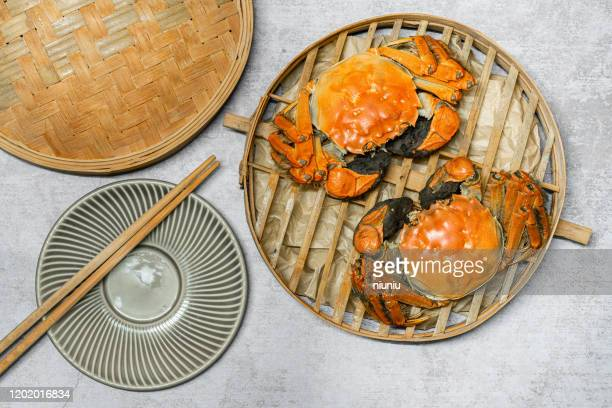 cooked crab, crab shell,eriocheir sinensis,crab claw,chinese hairy crab, hairy crab, blue crab, shanghai hairy crab,over white background,chinese crab - female hairy arms stock photos and pictures