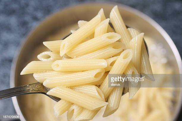 cooked penne rigate pasta in spoon