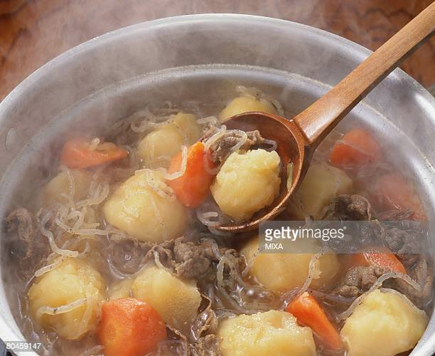 Cooked potato and carrot with meat