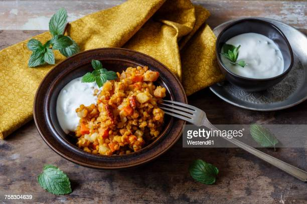 Cooked red lentils with vegetables and natural yoghurt with mint