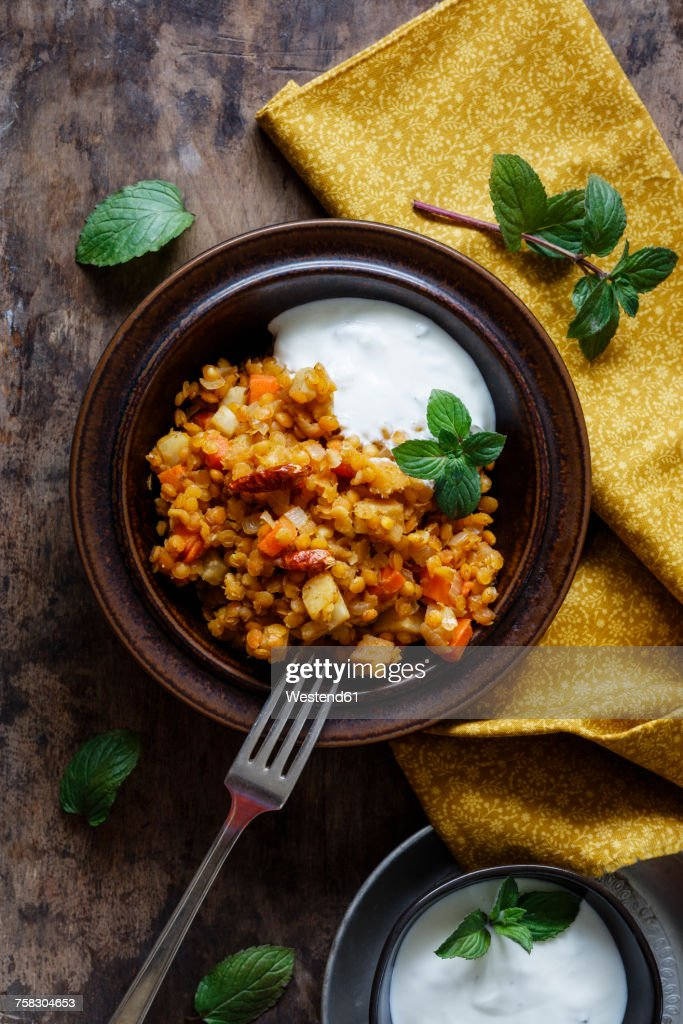 Cooked red lentils with vegetables and natural yoghurt with mint : Stock Photo