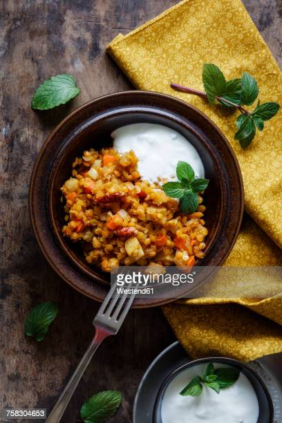 cooked red lentils with vegetables and natural yoghurt with mint - indian food stock photos and pictures