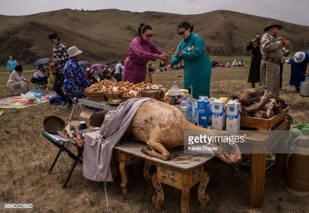 A cooked sheep that will offered during a Zugel Ritual is seen as Mongolian followers of Shamanism or Buu murgul prepare for the ceremony in the...