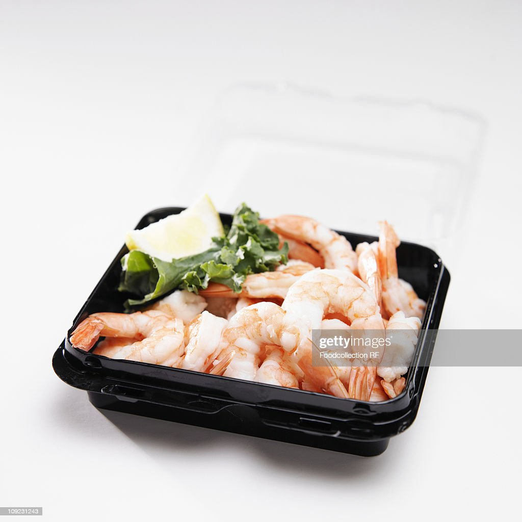 Cooked shrimps in container, close-up : Stock Photo