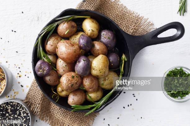 cooked small potatoes in a skillet - raw potato stock pictures, royalty-free photos & images