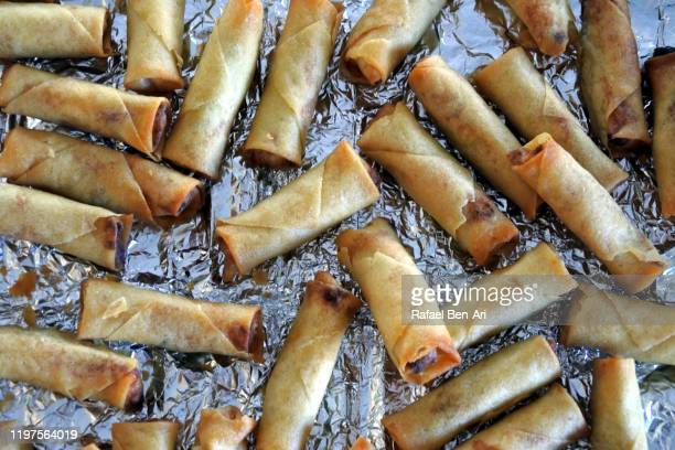 cooked spring roll on a cooking tray - rafael ben ari ストックフォトと画像