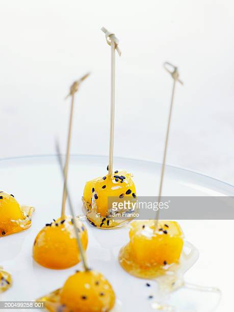 Cooked squash cubes with caramelized sugar coating and sesame seeds