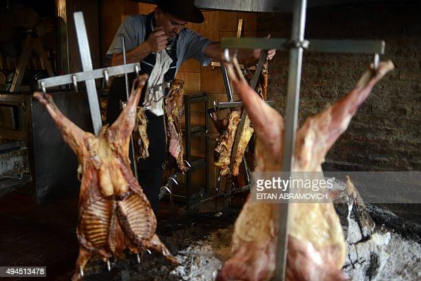 A cooker grills meat at a traditional grill restaurant in Buenos Aires on October 27 2015 Sausages ham and other processed meats cause bowel cancer...