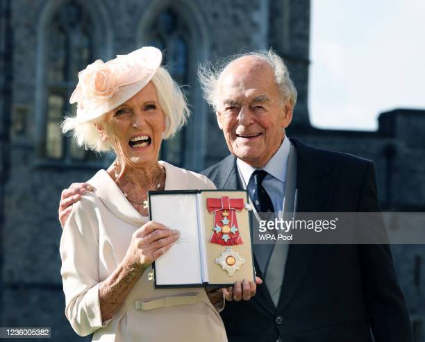 Cookery writer and broadcaster Mary Berry poses with her medal and star and husband Paul Hunnings following being appointed Dame Commander of the...