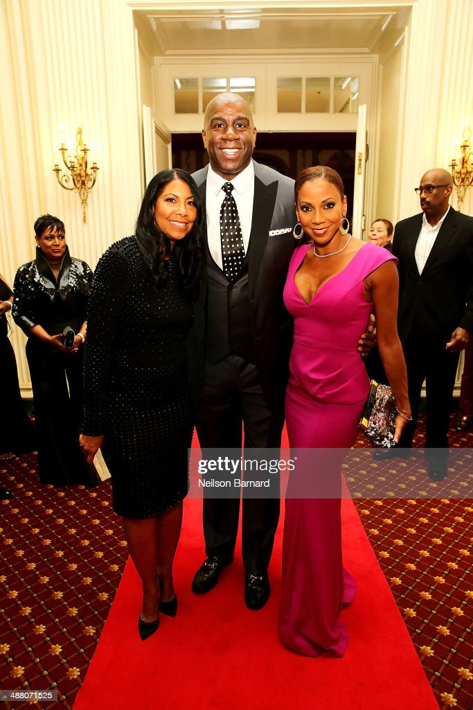 Cookie and Earvin 'Magic' Johnson and Holly Robinson Peete attend the 2014 Steve & Marjorie Harvey Foundation Gala presented by Coca-Cola at the Hilton Chicago on May 3, 2014 in Chicago, Illinois.