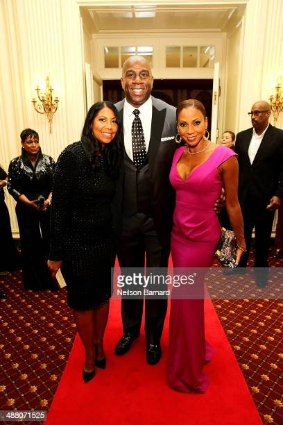 Cookie and Earvin Magic Johnson and Holly Robinson Peete attend the 2014 Steve Marjorie Harvey Foundation Gala presented by CocaCola at the Hilton...