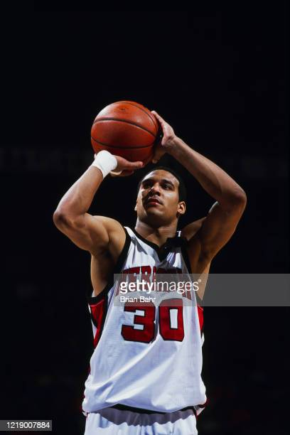 Cookie Belcher, Guard for the University of Nebraska Cornhuskers prepares to shoot during the NCAA Big 12 tournament college basketball game against...