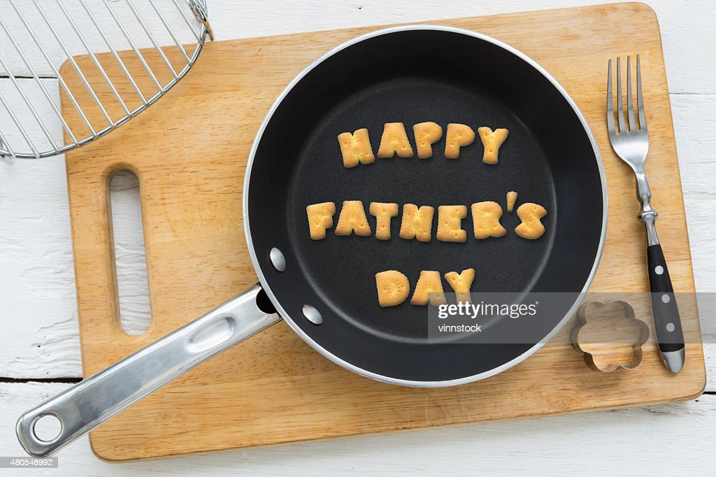 Cookie biscuits word HAPPY FATHER'S DAY in frying pan : Stock Photo