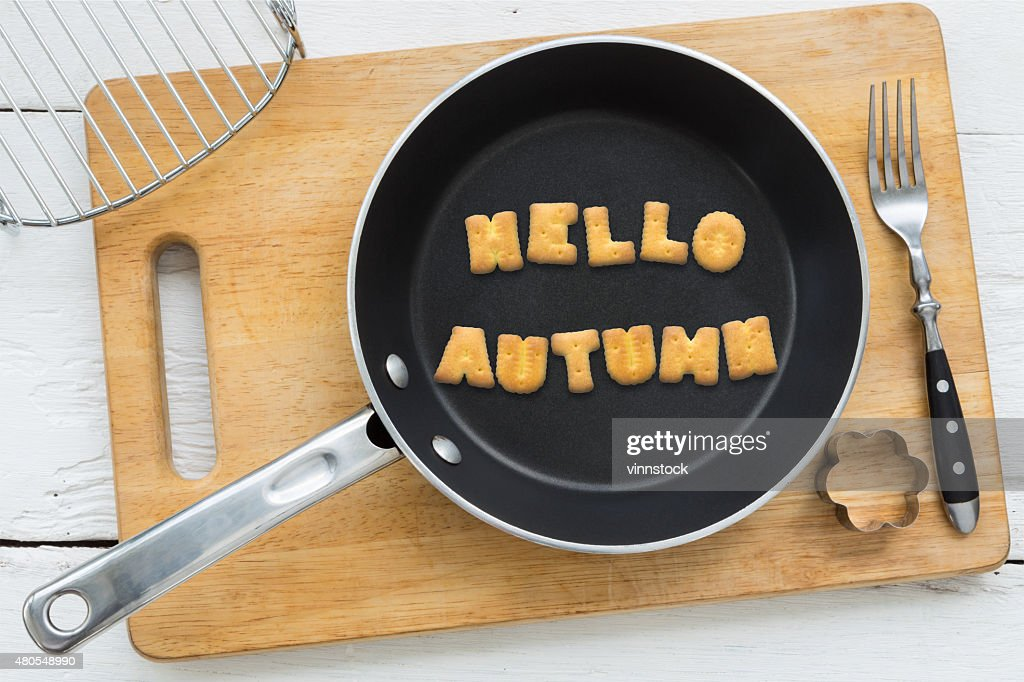 Cookie biscuits word HELLO AUTUMN in frying pan : Stock Photo