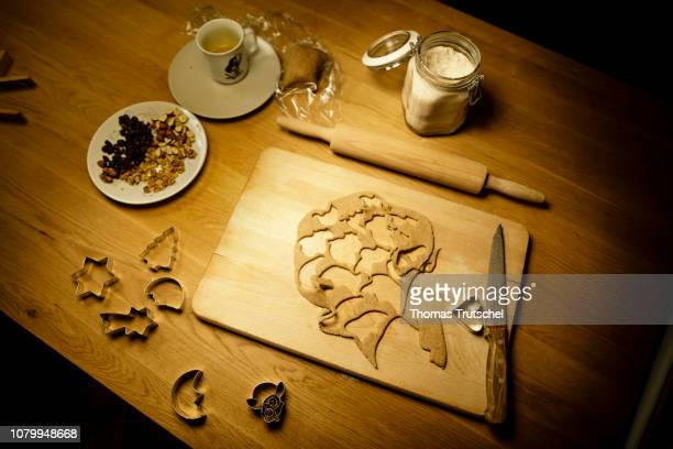 Cookie dough and cookie cutters are on a table with nuts on December 08 2018 in Berlin Germany