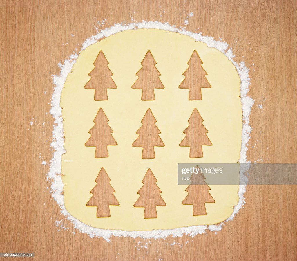 Cookie Dough With Christmas Tree Shapes Cut Out Stock Photo Getty