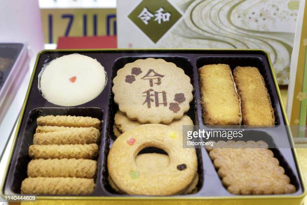 A cookie featuring the name of Japan's new imperial era Reiwa center top is displayed with other cookies in a box at a Matsuya Co department store on...