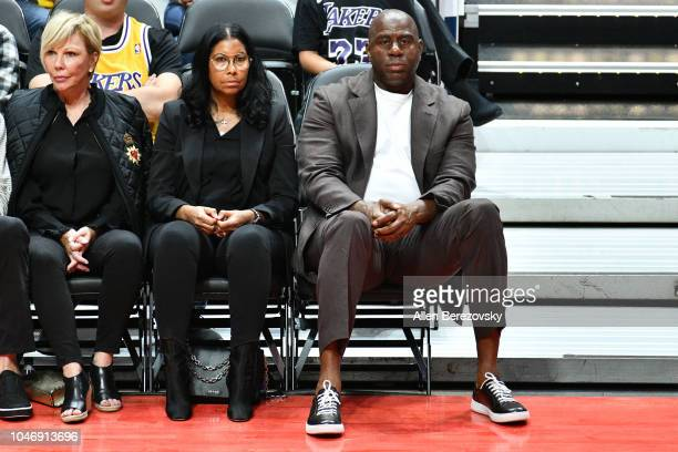 Cookie Johnson and Magic Johnson attend a basketball game between the Los Angeles Lakers and the Los Angeles Clippers at Honda Center on October 6...
