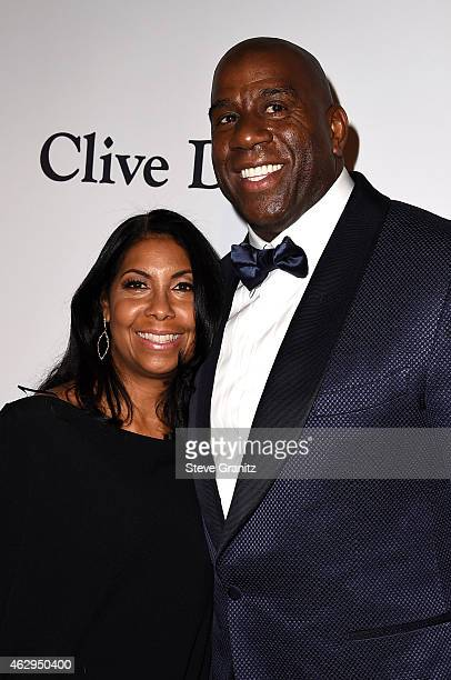 Cookie Johnson and Magic Johnson attend the PreGRAMMY Gala and Salute To Industry Icons honoring Martin Bandier on February 7 2015 in Los Angeles...