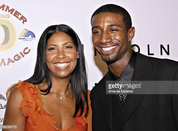 Cookie Johnson and son Andre Johnson arrive at the 20th Annual Midsummer Night's Magic Awards Dinner on July 13 2005 at the Century Plaza Hotel in...