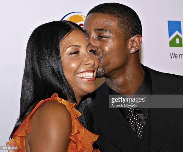 Cookie Johnson and son Andre Johnson arrive at the 20th Annual 'Midsummer Night's Magic Awards Dinner' on July 13 2005 at the Century Plaza Hotel in...
