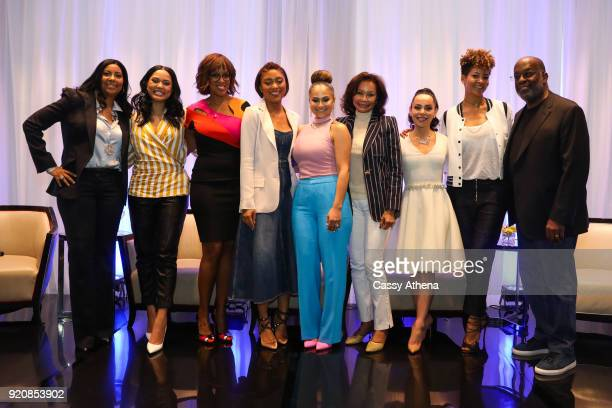 Cookie Johnson Ayesha Curry Gale King Jada Paul Mia Wright Elaine Baylor Adrienne Bosh Tracy Wilson Mourning and Bernard J Tyson pose together after...