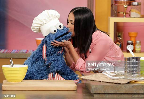 """Cookie Monster and Karla Martinez are seen during Sesame Street's visit of Univision's """"Despierta America"""" at Univision Headquarters on July 12, 2013..."""