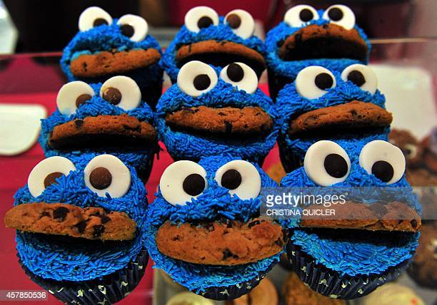 Cookie Monster cup cakes are exposed during the Sevilla creative pastry sweet fare at Fibes in Sevilla on October 25 2014 AFP PHOTO/ CRISTINA QUICLER