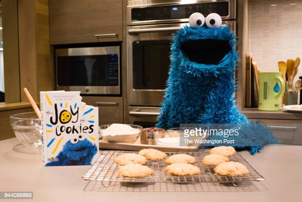 """Cookie Monster is pictured in the Washington Post Food Lab with a recipe from his new book, """"The Joy of Cookies."""""""