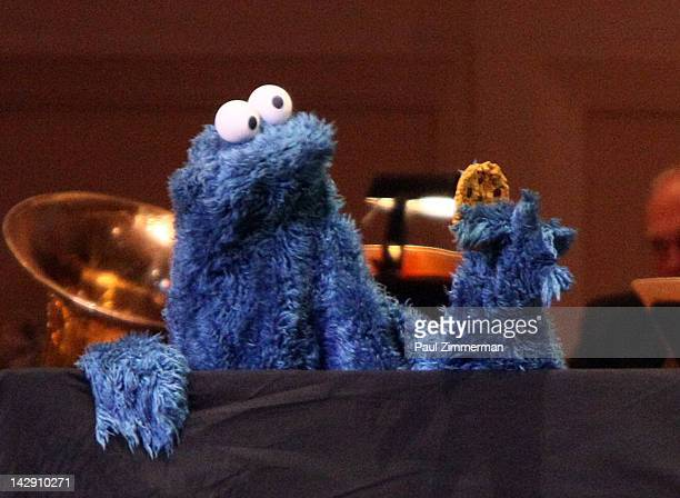 """Cookie Monster performs during The New York Pops Present """"Jim Henson's Musical World"""" at Carnegie Hall on April 14, 2012 in New York City."""