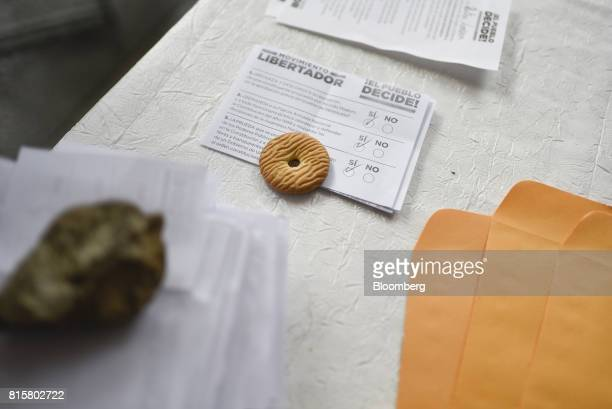 A cookie rests on a ballot paper marked 'Si' Spanish for 'Yes' during a symbolic Venezuelan plebiscite in the Chacao municipality of Caracas...