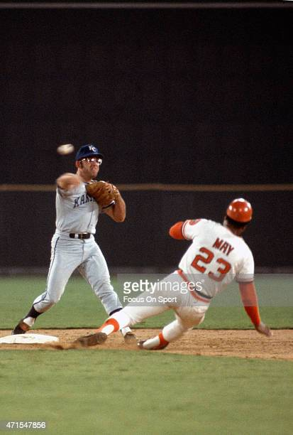 Cookie Rojas of the Kansas City Royals and American League AllStars gets his throw off to first base over the top of Lee May of the Houston Astros...