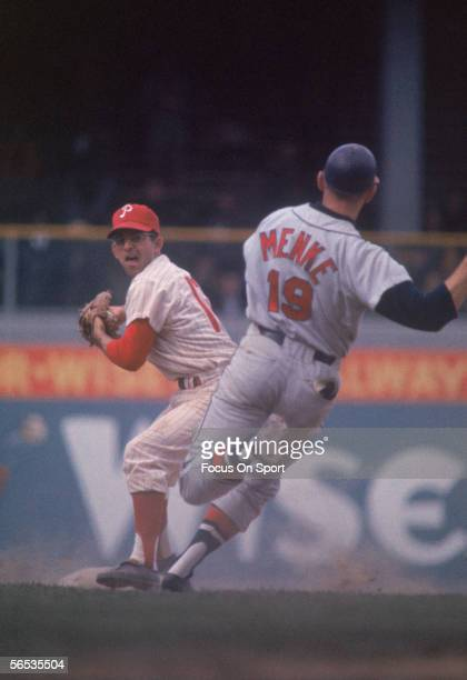Cookie Rojas of the Philadelphia Phillies stands on second and prepares to throw to first after forcing Denis Menke of the Milwaukee Brewers during a...